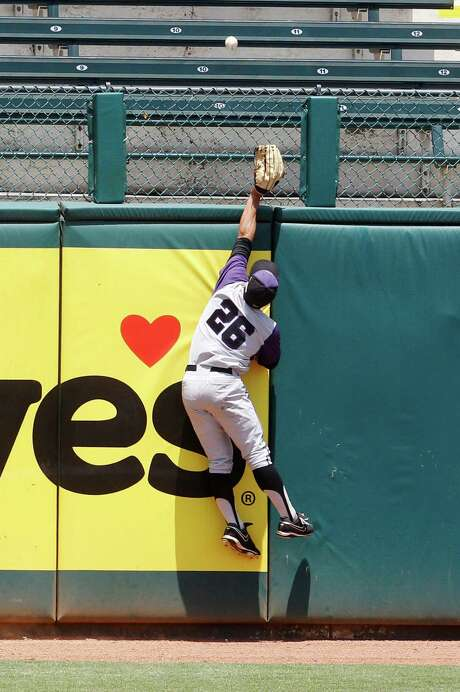 The leap by Kansas State's Jon Davis is in vain as Baylor's Josh Ludy homers in the fourth inning. / AP