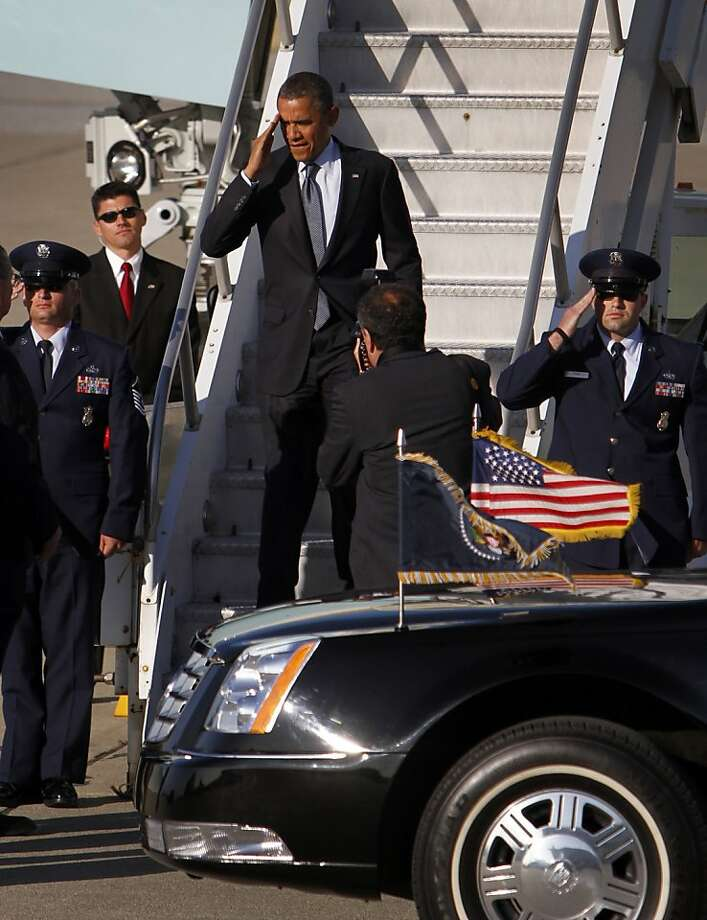 President Obama salutes as he exits Air Force One at Moffett Federal Airfield in Mountain View, Calif., Wednesday, May 23, 2012. Photo: Sarah Rice, Special To The Chronicle