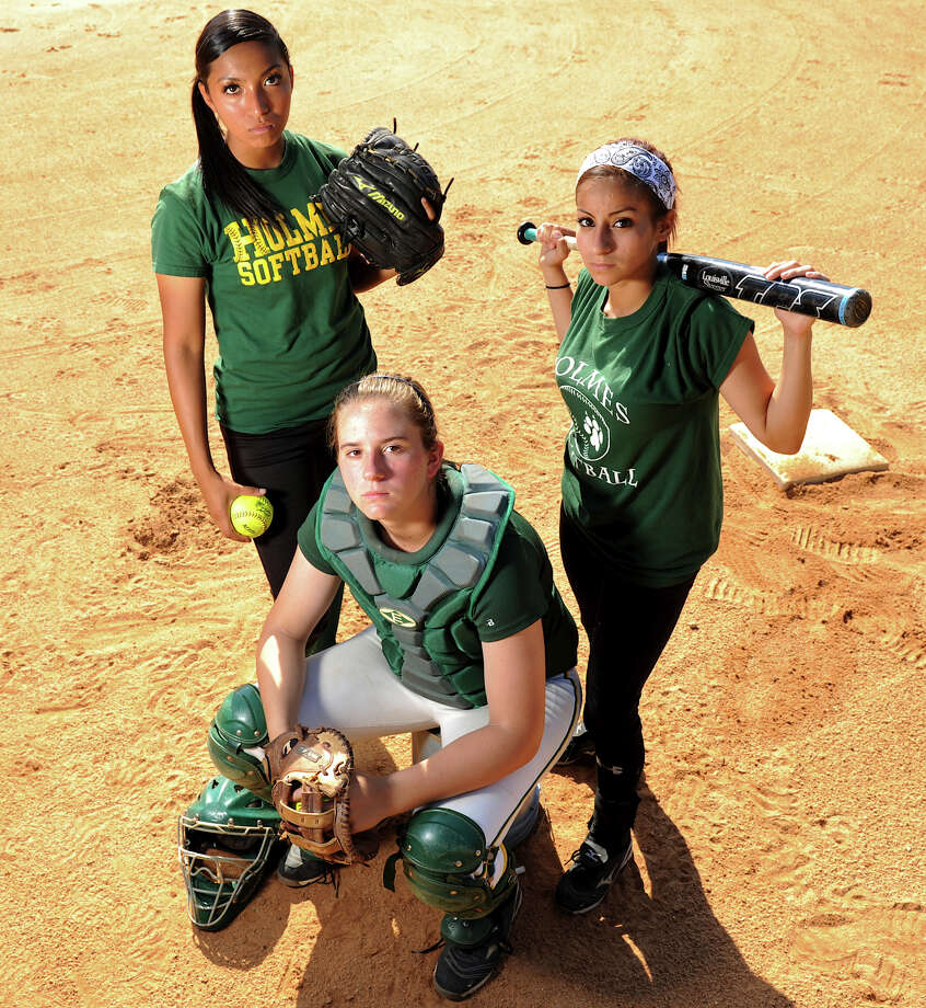 Holmes players Alessia Gallegos (left), Hailey Rebar and Christine Rosas will lead the Huskies against district rival O'Connor in the Region IV-5A title game Friday.   John Albright / Special to the Express-News.