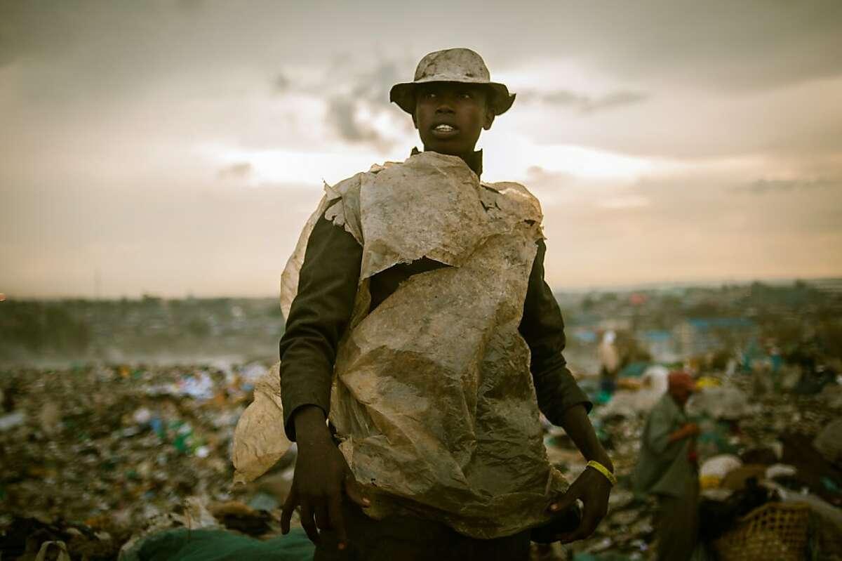 A picker surveys the Dandora slum outside of Nairobi, Kenya.