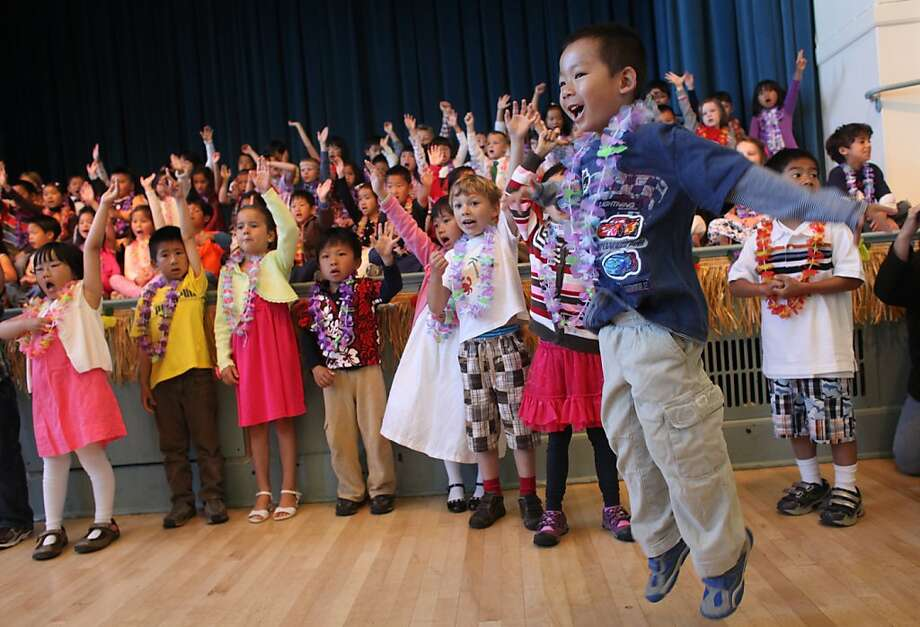 Tyler Mak, 6, a student in Lily Lee's kindergarten class, jumps for joy during the Francis Scott Key Elementary School kindergarten graduation/celebration in the auditorium Wednesday, May 23, 2012, in San Francisco, Calif. Photo: Judy Walgren, The Chronicle