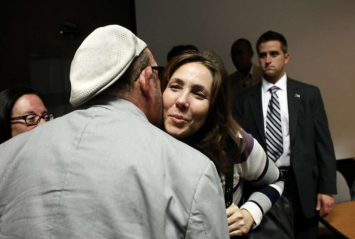 Mariela Castro Espin, daughter of Cuban President Raul Castro and niece of Fidel Castro, greets supporter Felix Kury after delivering a lecture about respect and health care for the Lesbian, Gay, Bisexual and Transgender community during her first U.S. visit , Wednesday at San Francisco General Hospital in San Francisco, Calif.