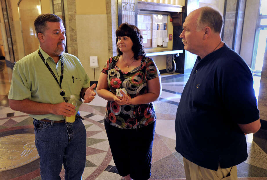 In a 10-week program, Greg Fountain, Nancy Lively and Mike Kirkpatrick lost a total of 113 pounds in a weight loss competition among Jefferson County Courthouse employees. Photo taken Tuesday, May 22, 2012 Guiseppe Barranco/The Enterprise Photo: Guiseppe Barranco, STAFF PHOTOGRAPHER / The Beaumont Enterprise