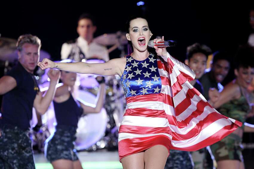 In this May 23, 2012 photo released by Starpix, singer Katy Perry wears a patriotic dress as she performs at a Pepsi-sponsored event at Brooklyn Pier 9A, kicking off Fleet Week in New York. (AP Photo/Starpix, Amanda Schwab)