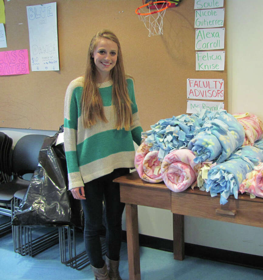 Darien High School senior and Community Council leader McKinley Stauffer arranged the Blankets for Preemies day at DHS on March 16, 2012, where students completed more than 60 blankets throughout the day. Darien, Conn. Photo: Contributed Photo