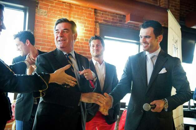 "Mayor Michael Pavia Maksim joins brothers Maksim, left, and Val Chmerkovskiy, center, and Tony Dovolani, all dancers on ABC's reality competition ""Dancing With the Stars,"" open Dance With Me Stamford, their fourth ballroom dance studio and their first in Connecticut, on Summer Street in Stamford, Conn., May 23, 2012. Photo: Keelin Daly / Stamford Advocate"