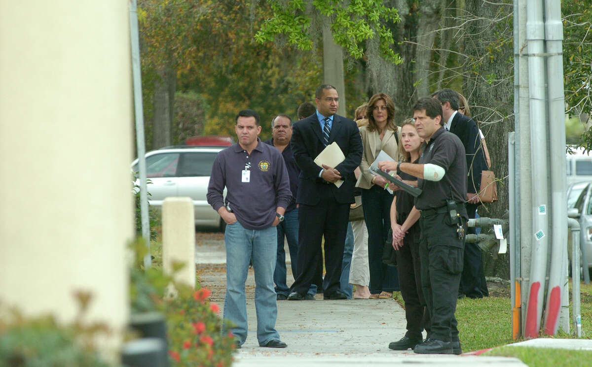 Albany County District Attorney David Soares, center, waits on the sidewalk outside Signature Compounding Pharmacy in Orlando, Fla., on Tuesday, Feb. 27, 2007. (Paul Buckowski/Times Union archive)