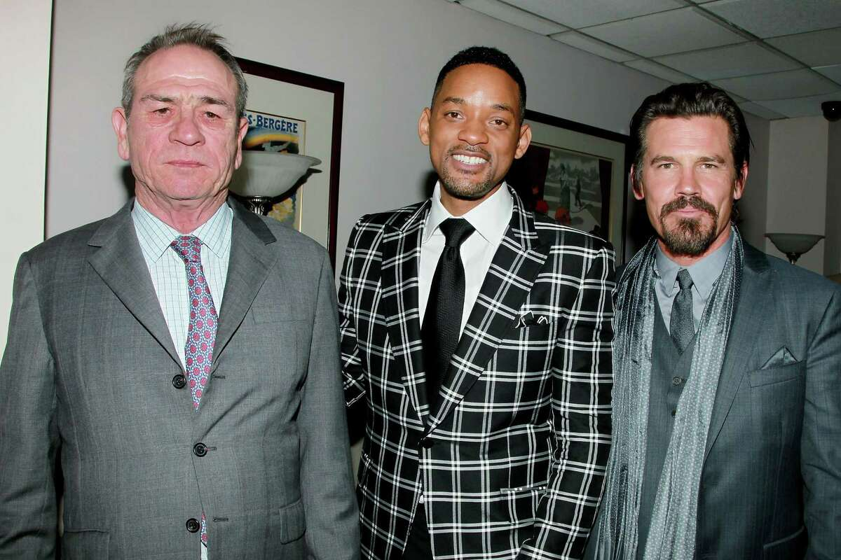 In this Wednesday, May 23, 2012 photo released by Starpix, from left, Tommy Lee Jones, Will Smith and Josh Brolin pose at the premiere of their film