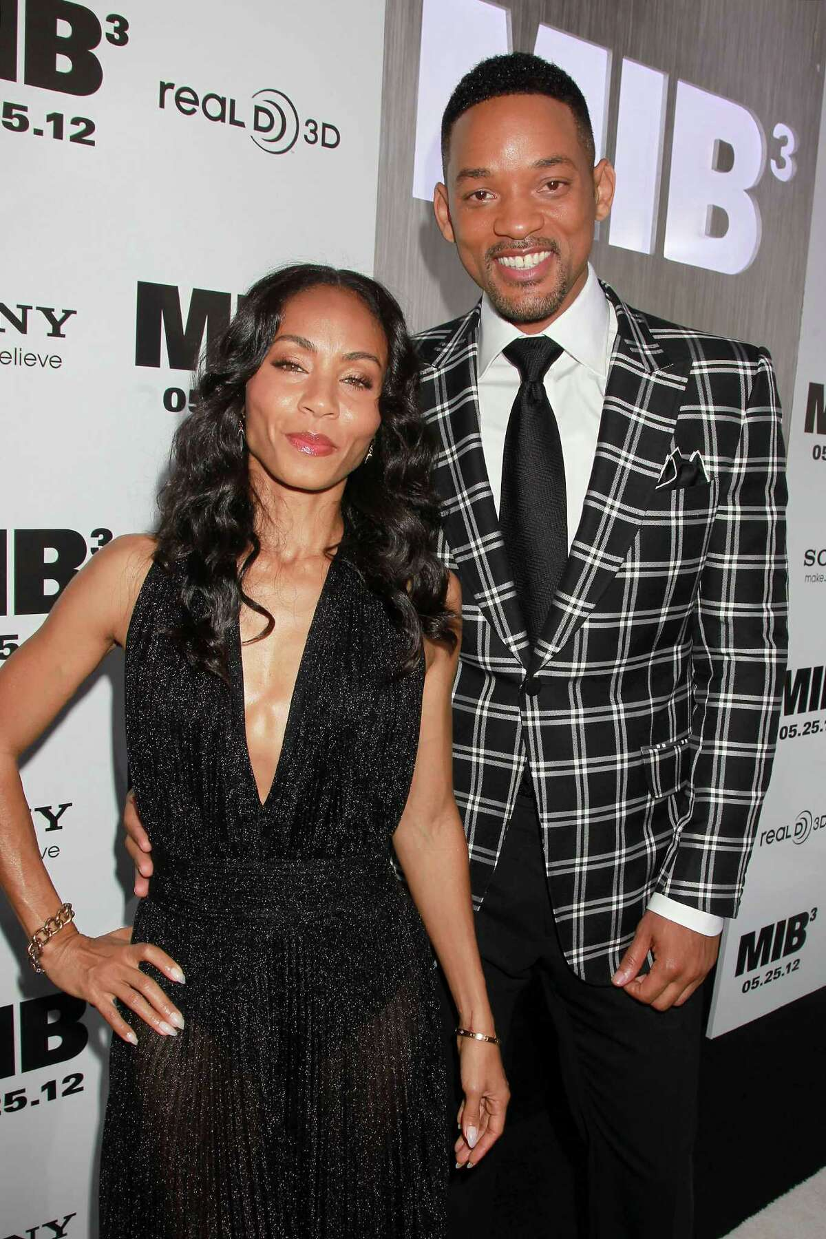 In this Wednesday, May 23, 2012 photo released by Starpix, Jada Pinkett-Smith, left, and her husband Will Smith arrive at the premiere of his film,