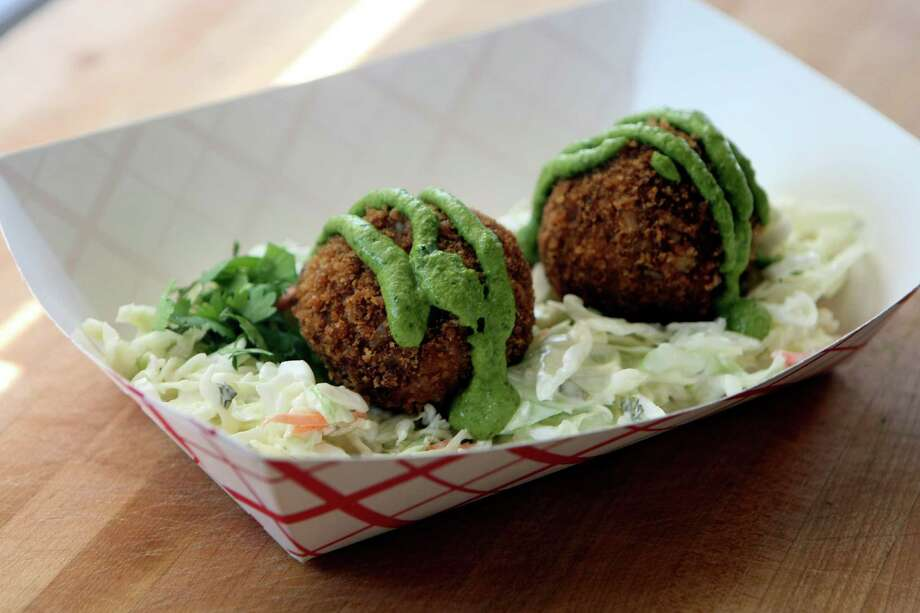 Boudin balls from The Rolling Pig. Photo: Helen L. Montoya, San Antonio Express-News / ©SAN ANTONIO EXPRESS-NEWS