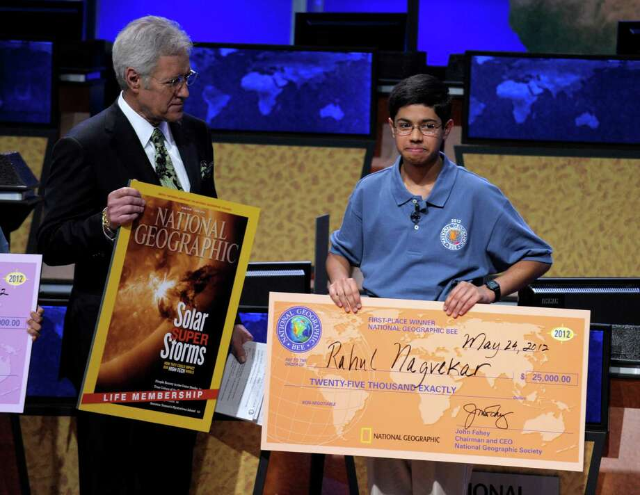 National Geographic Bee host Alex Trebek stands with National Geographic Bee champion Rahul Nagvekar, 14, from Quail Valley Middle School in Missouri City, Texas, Thursday, May 24, 2012, in Washington, . (AP Photo/Susan Walsh) Photo: Susan Walsh, Associated Press / AP