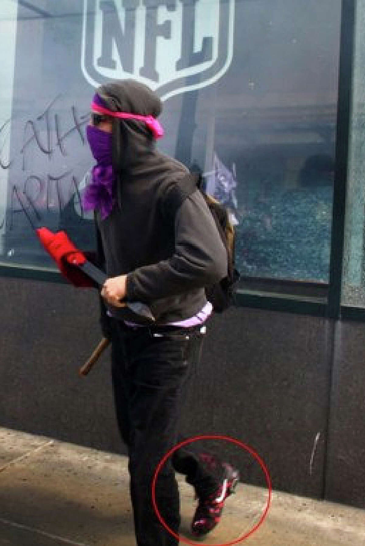 The man pictured above -- in Nike shoes, it seems -- is suspected of smashing windows at Niketown in downtown Seattle.