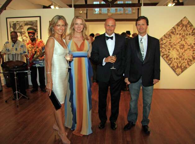 New Canaan residents Stephanie Joyce, second from left, and husband Jim Vos, first on right, were sponsors of the 90th anniversary benefit and hosted a table at the sold-out fundraising event in New Canaan Conn. May 5. Photo: Contributed Photo