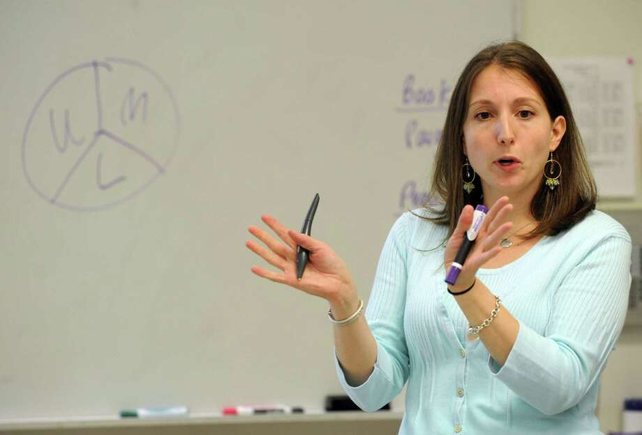 Kristen Sileo teaches a 7th-grade math class at Scofield Middle School in Stamford on Thursday, May 24, 2012. Photo: Lindsay Niegelberg / Stamford Advocate