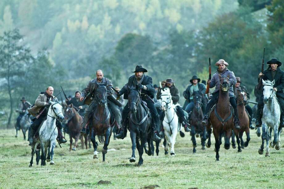 The warring Hatfield family, led by Devil Anse Hatfield (Kevin Costner) prepares to fight the McCoys Photo: KEVIN LYNCH, HISTORY CHANNEL