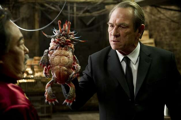 "Keone Young (left) and Tommy Lee Jones holding ""Spiky Bulba"" in Columbia Pictures' MEN IN BLACK 3. Photo: Wilson Webb, Sony Pictures"