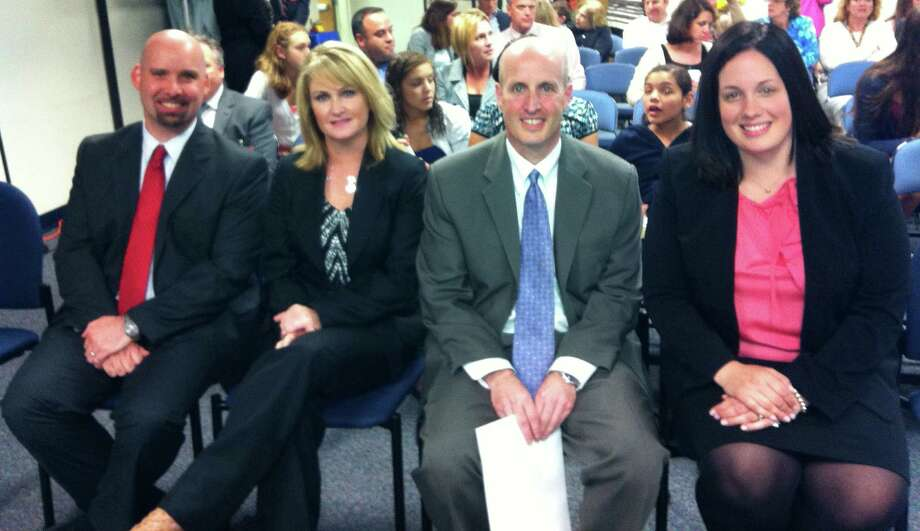 Schools Superintendent David Title introduced new principals to four of Fairfield's elementary schools to the Board of Education at its meeting Tuesday night. The appointees are, left to right, Scott Bannon at Dwight; Elizabeth McGoey at Stratfield; Jason Bluestein at Burr; and Laura Cretella at Holland Hill. Photo: Michael C. Juliano/Staff Photo