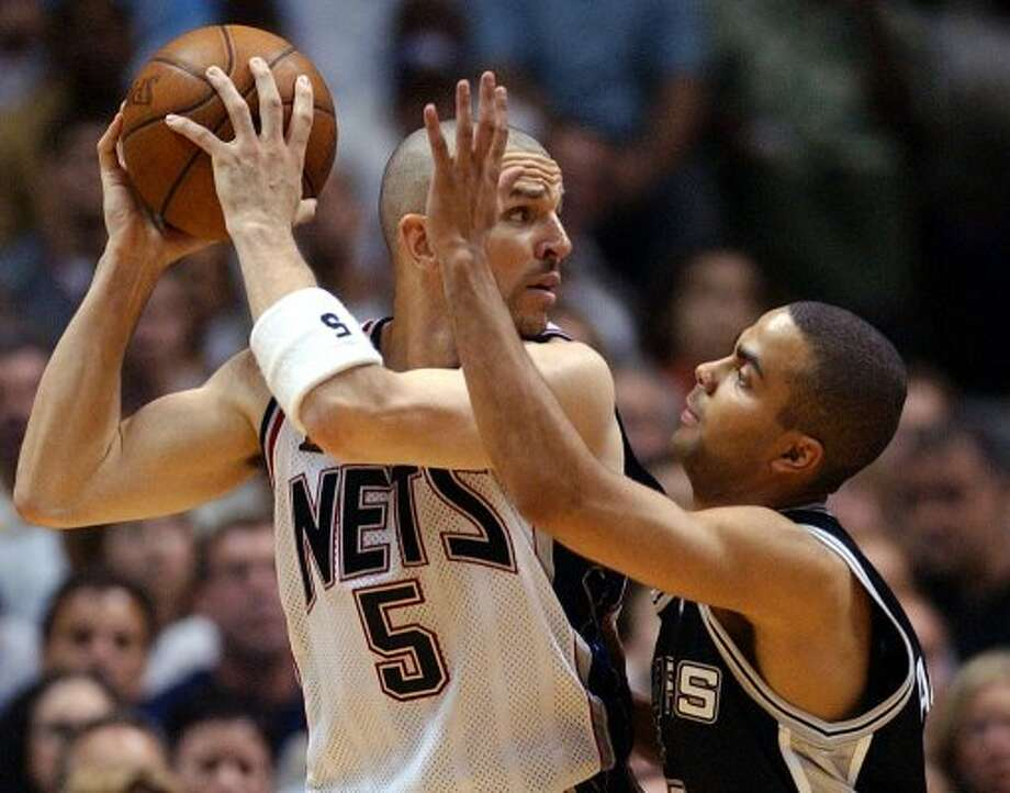 2003 starting point guard: Spurs' Tony Parker (right) tightly defends New Jersey's Jason Kidd (05) during fourth quarter of game four of the NBA Finals at the Continental Airlines Arena in New Jersey on Wednesday, June 11, 2003.  (SAN ANTONIO EXPRESS-NEWS)