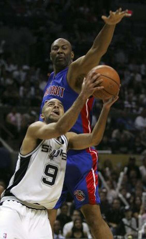 2005 starting point guard: Spurs Tony Parker looks to shoot as Pistons Elden Campbell defends during second quarter action game 7 of the NBA Finals at the SBC Center in San Antonio June 23, 2005.  (KIN MAN HUI / SAN ANTONIO EXPRESS-NEWS)