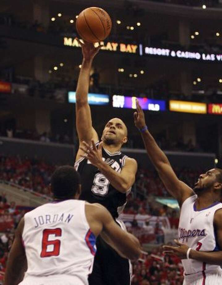 2012 starting point guard: San Antonio Spurs' Tony Parker (09) shoots against Los Angeles Clippers' Chris Paul (03) and DeAndre Jordan (06) in the first quarter during game four of the Western Conference semifinals at Staples Center in Los Angeles, Sunday, May 20, 2012.   (San Antonio Express-News)