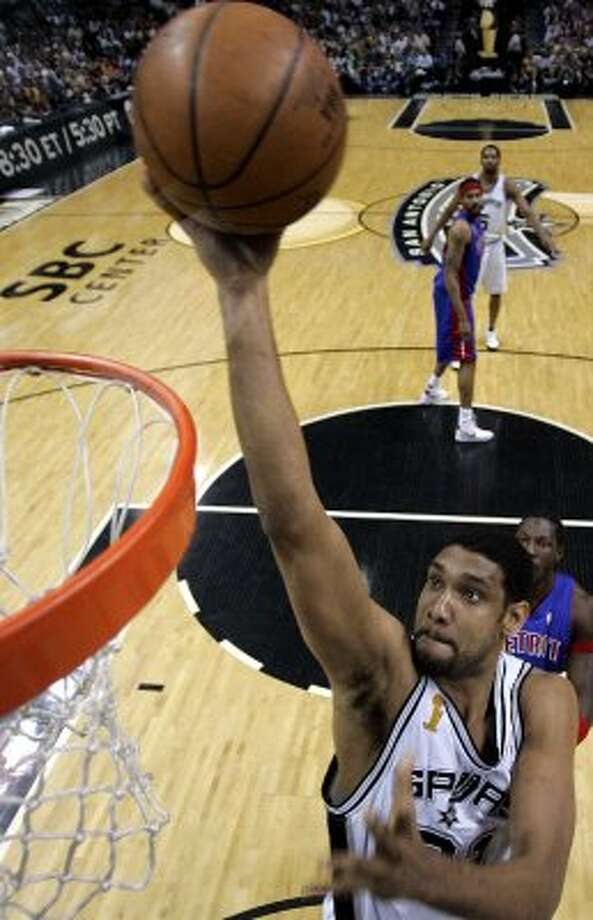 2005 starting power forward: San Antonio Spurs Tim Duncan (21) lays the ball up in the first quarter against the Detroit Pistons in game two of the NBA finals in San Antonio, Sunday, June 12, 2005. (AP)