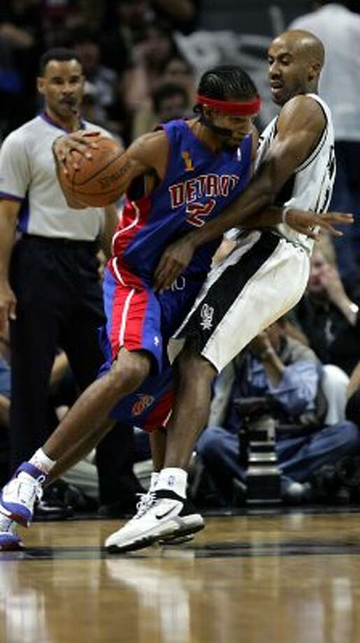 2005 starting small forward: Detroit Pistons' Richard Hamilton (32) tries to get past San Antonio Spurs' Bruce Bowen (12) during the third quarter in game two of the NBA finals in San Antonio, Sunday, June 12, 2005. (AP)