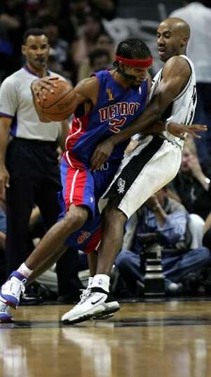 2005 starting small forward: Detroit Pistons' Richard Hamilton (32) tries to get past San Antonio Sp