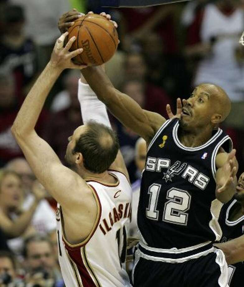 2007 starting small forward: Spurs' forward Bruce Bowen (12) rips the ball from Cleveland Cavaliers center Zydrunas Ilgauskas (11), of Lithuania, during first quarter action in the NBA Finals game four in Cleveland June 14, 2007.   (SAN ANTONIO EXPRESS-NEWS)
