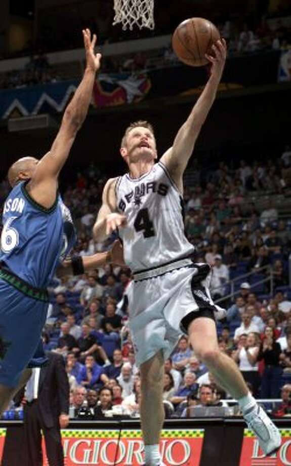 1999 reserves: San Antonio Spurs Steve Kerr scores over Minnesota Timberwolves James Robinson during fourth quarter NBA action at the Alamodome on Wednesday, April 14, 1999. The Spurs beat the Timberwolves, 95-79.