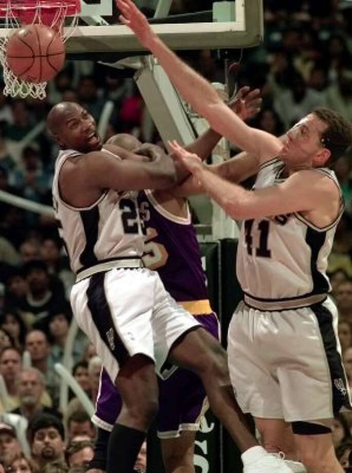 1999 reserves: The Spurs Jerome Kersey (25) and Will Purdue knock the ball away from the Lakers Sean Rooks while playing tight defense while helping the Spurs to a 15 point half time lead Saturday April 24, 1999.
