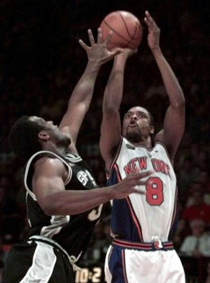 1999 reserves: New York Knicks' Latrell Sprewell (8) shoots over San Antonio Spur's Malik Rose, left, during the fourth quarter of Game 5 of the 1999 NBA Finals Friday, June 25, 1999, at New York's Madison Square Garden. (AP)