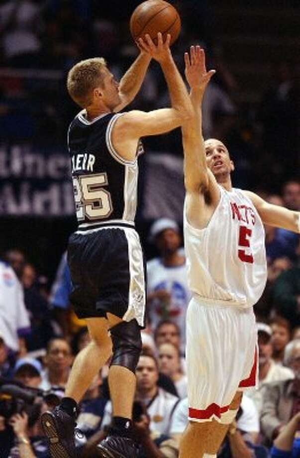 2003 reserves: San Antonio Spurs Steve Kerr fires off a shot late during the fourth quarter as New Jersey Nets Jason Kidd arrives too late in game five of the NBA Finals at Continental Airlines Arena in New Jersey on Friday, June 13, 2003. (SAN ANTONIO EXPRESS-NEWS)