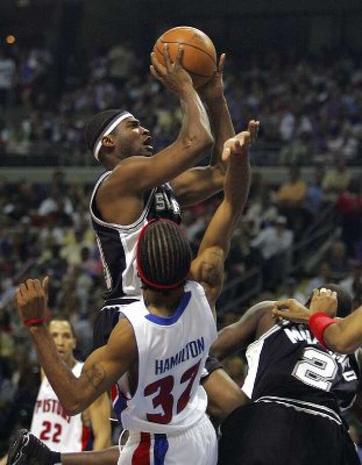 2005 reserves: Spurs Devin Brown seeing some early action as he continues to recover from a back injury shoots over Pistons Richard Hamilton during second quarter action game four NBA Finals on Thursday, June 16, 2005 at the Palace at Auburn Hills.  (BAHRAM MARK SOBHANI / SAN ANTONIO EXPRESS NEWS)