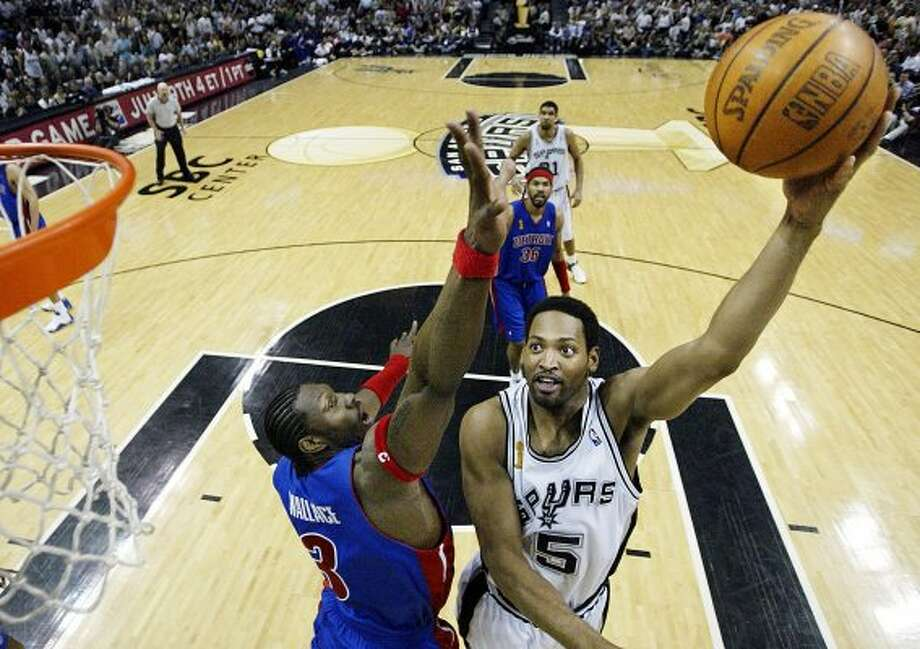 2005 reserves: San Antonio Spurs' Robert Horry, right, shoots over Detroit Pistons' Ben Wallace during the first quarter in game seven of the NBA finals in San Antonio, Tuesday, June 23, 2005. (AP)