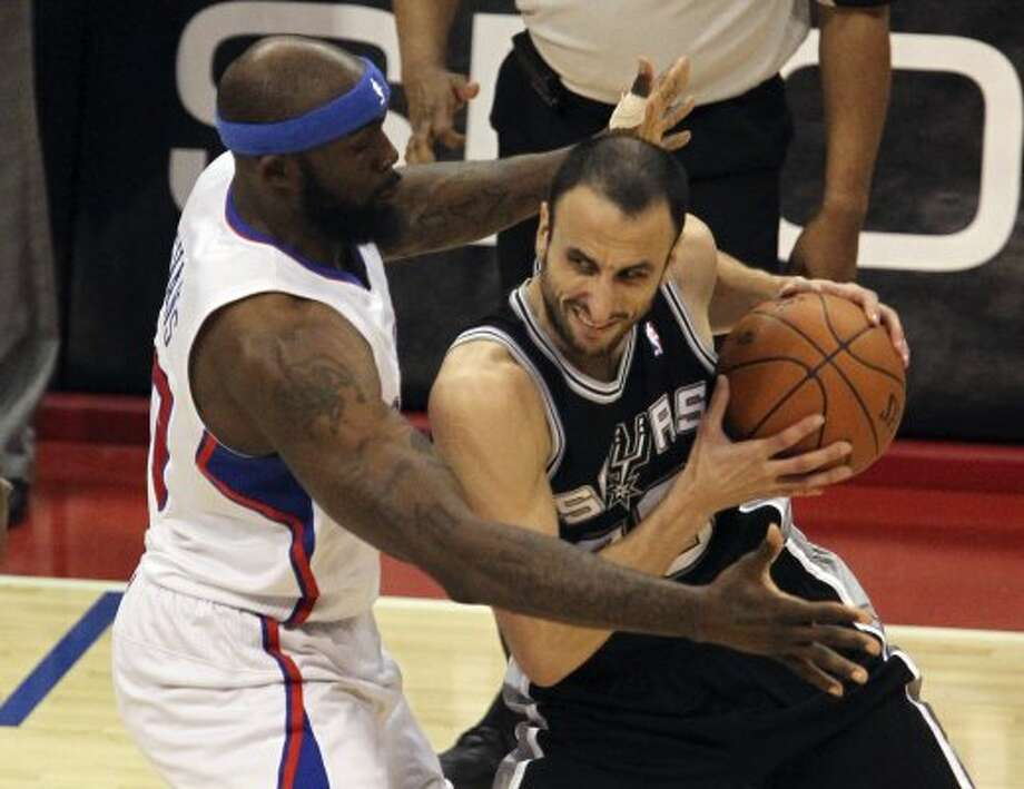 2012 reserves: San Antonio Spurs Manu Ginobili (20) keeps the ball away from Los Angeles Clippers Reggie Evans (30), during the second half of game three of the Western Conference semifinals at Staples Center in Los Angeles, Saturday, May 19, 2012.  Spurs defeated the Clippers, 96-86. (San Antonio Express-News)