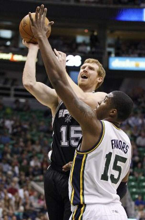 2012 reserves: Spurs' Matt Bonner shoots over Jazz's Derrick Favors during first half action of Game 4 of the Western Conference first round Monday May 7, 2012 at EnergySolutions Arena in Salt Lake City, Utah.  (SAN ANTONIO EXPRESS-NEWS)