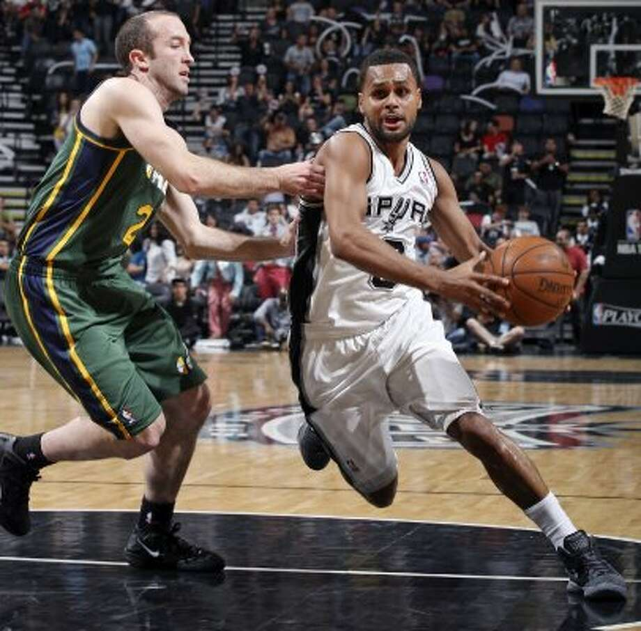 2012 reserves: San Antonio Spurs Patty Mills drives around Utah Jazz Blake Ahern during second half action of Game 2 of the Western Conference first round Wednesday May 2, 2012 at the AT&T Center. The Spurs won 114-83.   (SAN ANTONIO EXPRESS-NEWS)