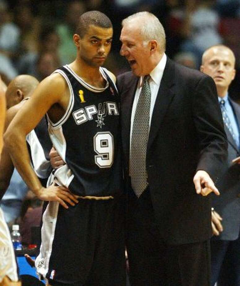 2003 coach: Spurs coach Gregg Popovich talks with Tony Parker during fourth quarter action of game four NBA Finals at the Continental Airlines Arena in New Jersey June 11, 2003.  (SAN ANTONIO EXPRESS-NEWS)