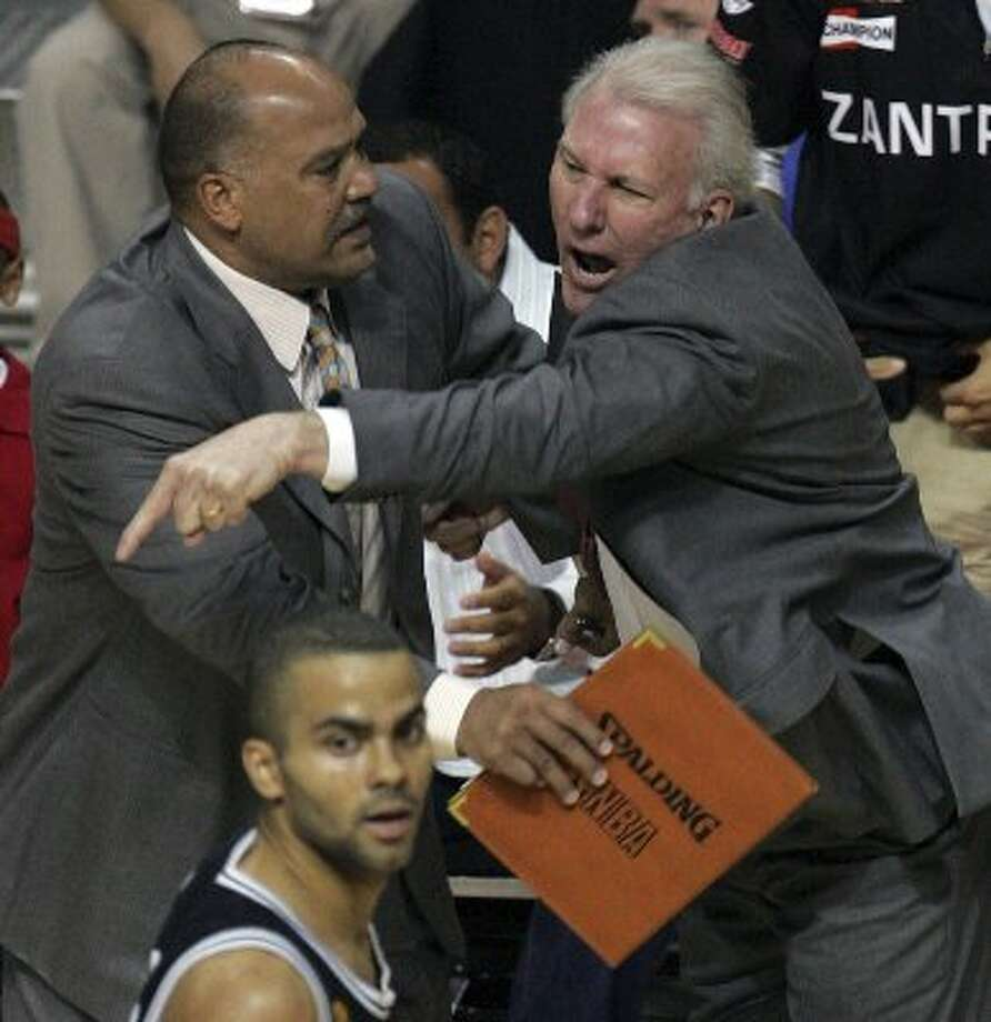 2005 coach: Spurs' coach Gregg Popovich reacts to a technical foul called against him as assistant coach Don Newman holds him back during first  quarter action game four of the NBA Finals at The Palace of Auburn Hills near Detroit, Michigan on Tuesday, June 14, 2005. (KIN MAN HUI / SAN ANTONIO EXPRESS-NEWS)