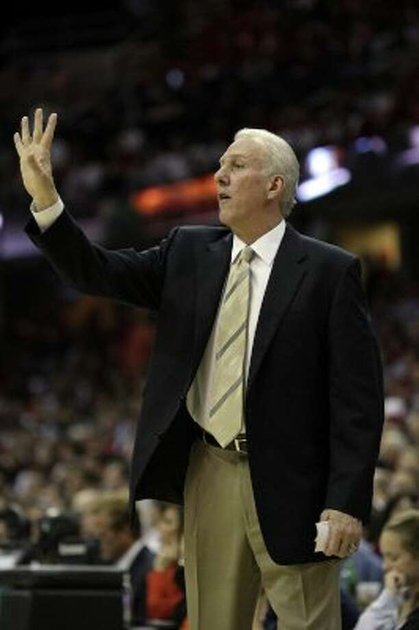 2007 coach: Spurs' coach Gregg Popovich gestures to his players during first quarter action in the NBA Finals game four in Cleveland June 14, 2007.  (SAN ANTONIO EXPRESS-NEWS)