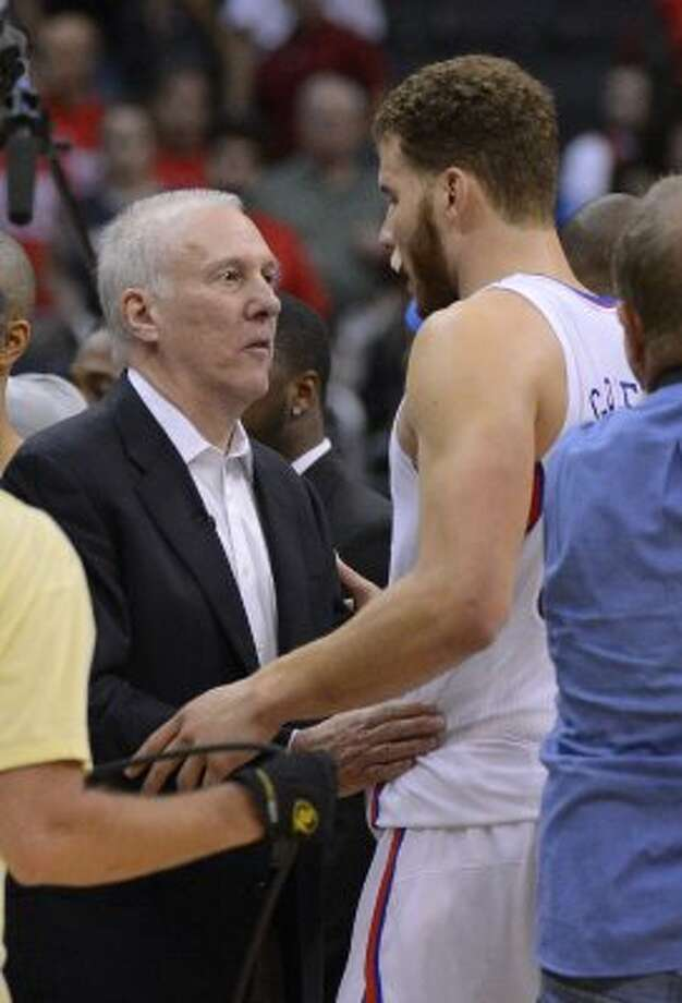2012 coach: San Antonio Spurs head coach Gregg Popovich, left, talks with Los Angeles Clippers forward Blake Griffin after Game 4 of an NBA basketball playoffs Western Conference semifinal, Sunday, May 20, 2012, in Los Angeles. The Spurs won 102-99. (AP)