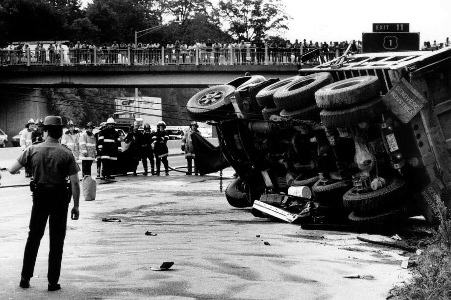 May 29, 1987: Dozens of spectators watch from the Old Kings Highway overpass near exit 13 on I-95 as highway crews attempt to right and overturned truck. Photo: File Photo