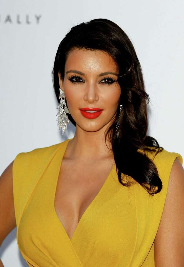 "Kim Kardashiandefended herself against John Hamm's claim that she and her friends were ""idiots."" Kardashian then went on to proclaim being a ""business woman."" Sure, Kim. Keep telling yourself that. Photo: Andreas Rentz, Getty Images / 2012 Getty Images"