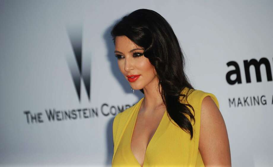 Kim Kardashian, whose net worth is estimated at $38 million, can be your party host for just $300,000. Photo: Jonathan Short, Associated Press / SHORJ