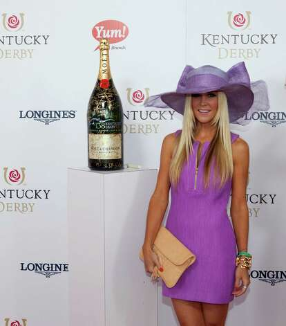 "LOUISVILLE, KY - MAY 05:  Red Carpet/Celebrity Signing Moment: Tinsley Mortimer signs a limited edition 6 Liter Moet & Chandon Imperial bottle for the brands philanthropic initiative ""Sign for the Roses"", on the red carpet at the 138th Kentucky Derby on May 5, 2012 in Louisville, Kentucky.  (Photo by Joey Foley/Getty Images for Moet) Photo: Joey Foley / 2012 Getty Images"