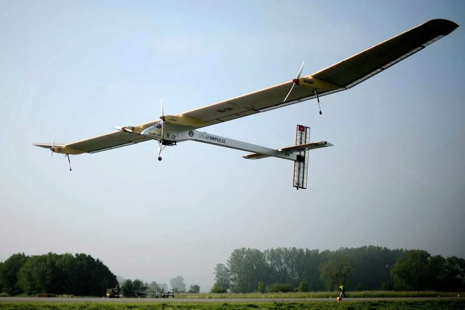 "The experimental aircraft ""Solar Impulse"", HB-SIA, carrying Solar Impulse's Chief Executive Officer and pilot Andre Borschberg takes off for its first intercontinental flight to Morocco at the airbase in Payerne, Switzerland, Thursday, May 24, 2012. Solar-powered aircraft Solar Impulse, the zero fuel airplane, makes its first intercontinental trip with the final destination of Rabat, Morocco. The prototype will land in Madrid, Spain for a technical layover, as well as to change pilots. The Solar Impulse project aims to circumnavigate the world with an aircraft, with a 63.40 meters wingspan, powered only by solar energy. Photo: Laurent Gillieron, AP / KEYSTONE"