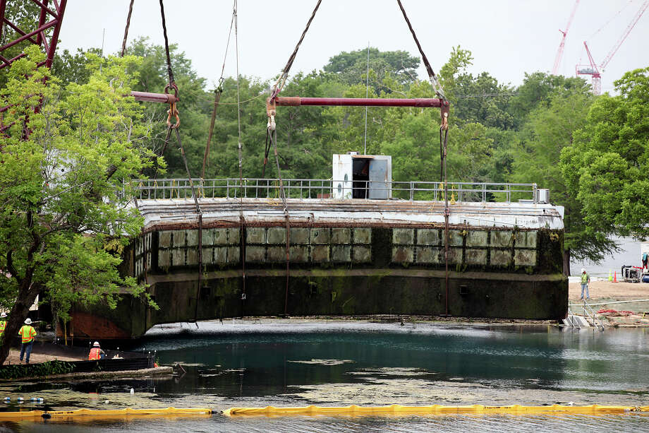 The Aquarena Springs sub is liftedout of the water in San Marcos, Thursday, May 24, 2012. The sub used to be a tourist attraction for over 50 years. It was closed to the public 15 years ago. Photo: Jerry Lara, San Antonio Express-News / © San Antonio Express-News