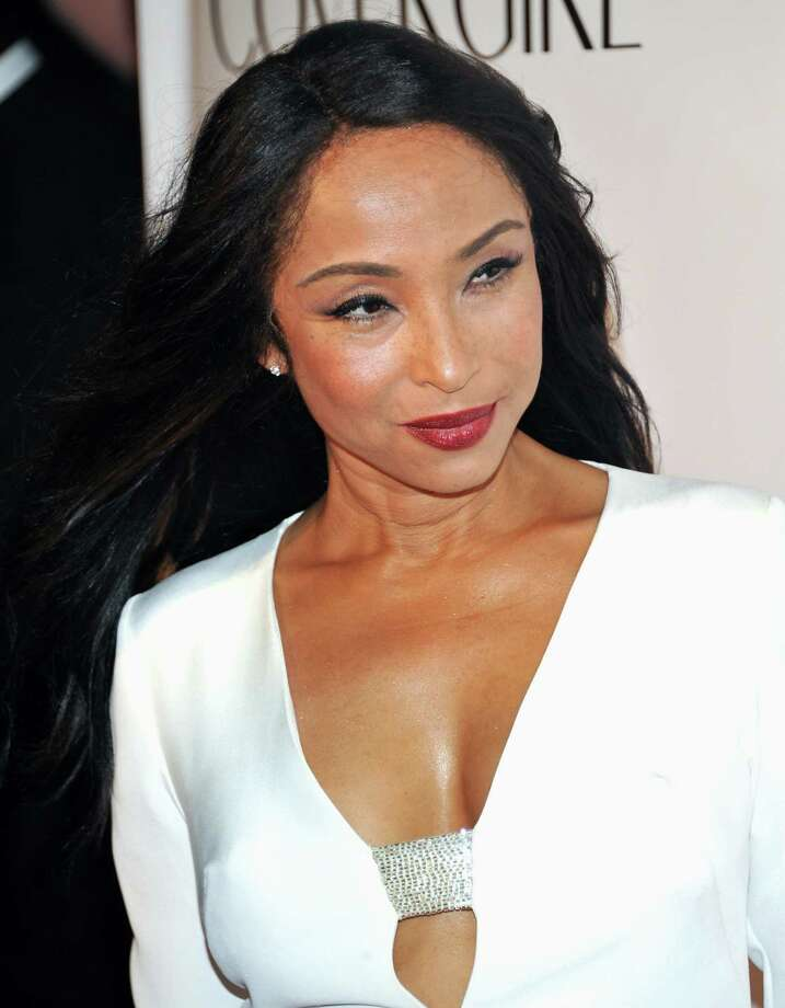 "FILE - In this Sept. 30, 2010 file photo, singer Sade Adu arrives at the ""Keep A Child Alive Black Ball"" at the Hammerstein Ballroom in New York. Sade, the Grammy-winning veteran soul band, released a live DVD this week called ""Bring Me Home – Live 2011."" It features behind-the-scene moments and more from the group's U.S. tour last year. Photo: AP"