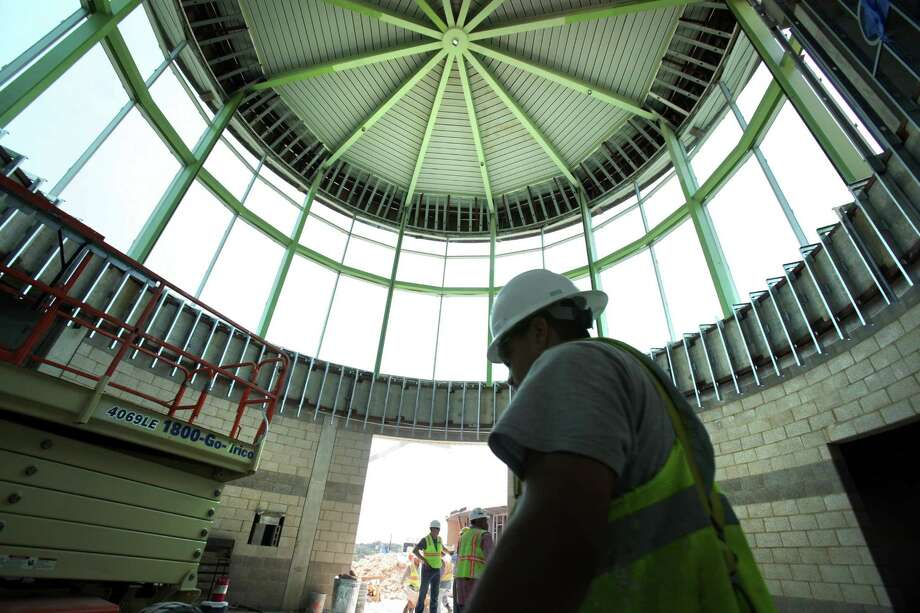 A construction worker walks through the rotunda at the construction site of Las Lomas Elementary School.  Two new North East Independent School District Elementary schools will not open as planned in August, Vineyard Ranch Elementary and Las Lomas Elementary.  Wednesday, May 24, 2012. Photo: Bob Owen, San Antonio Express-News / © 2012 San Antonio Express-News