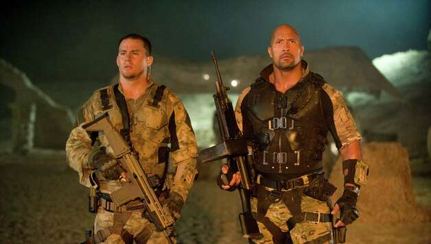 "In this film image released by Paramount Pictures, Channing Tatum, left, and Dwayne Johnson are shown in a scene from ""G.I. Joe: Retaliation."" (AP Photo/Paramount Pictures, Jaimie Trueblood) Photo: Jaimie Trueblood"